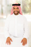 Arabian man sitting home Stock Images