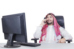 Arabian man speaking on cellphone Royalty Free Stock Photos
