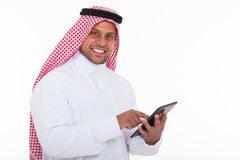 Arabian man tablet. Happy arabian man using tablet computer on white background Stock Photography