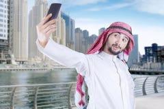 Arabian man taking self portrait Stock Images