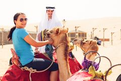 Arabian Man And Tourist Riding A Camel Royalty Free Stock Images