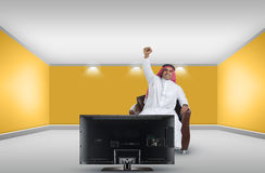 Arabian man watching TV and reacting Stock Photography