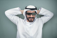 Arabian man wearing 3d glasses. Isolated on a green pastel background Royalty Free Stock Photography