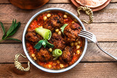 Arabian meatballs kofte with chickpeas, spicy tomato sauce and mint Royalty Free Stock Photos