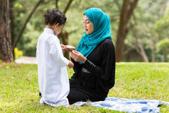 Arabian mother playing boy Royalty Free Stock Photo