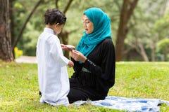 Arabian mother playing boy royalty free stock photo