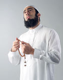 Arabian muslim man holding rosemary and praying Royalty Free Stock Photo