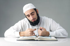 Arabian muslim man reading Quran Royalty Free Stock Image