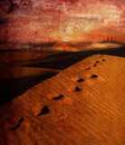 Arabian night. Footsteps in desert leading towards palace on horizon Royalty Free Stock Images