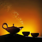 Arabian old ceramic teapot with cups. In same style Royalty Free Stock Photography