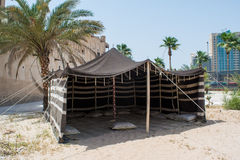 Arabian old style booth on the sand near palm trees Royalty Free Stock Images