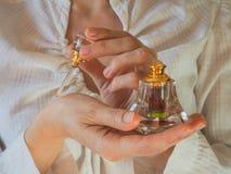 Arabian oud attar perfume or agarwood oil fragrances in crystal bottle. Arabian oud attar perfume or agarwood oil fragrances in crystal bottle Royalty Free Stock Photos