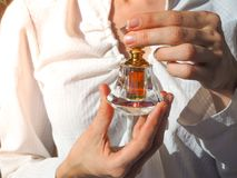 Arabian oud attar perfume or agarwood oil fragrances in crystal bottle. Arabian oud attar perfume or agarwood oil fragrances in crystal bottle Stock Photo