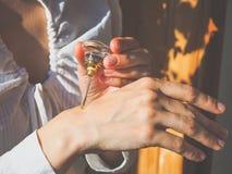 Arabian oud attar perfume or agarwood oil fragrances in crystal bottle. Arabian oud attar perfume or agarwood oil fragrances in crystal bottle Royalty Free Stock Photography