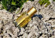 Arabian oud attar perfume or agarwood oil fragrances in mini bottle. Arabian oud attar perfume or agarwood oil fragrances in mini bottles on a natural Royalty Free Stock Images