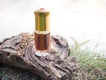 Arabian Oud Attar Perfume Or Agarwood Oil Fragrances In Mini Bottle. Royalty Free Stock Photography