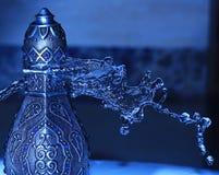 Arabian Oud Bottel Under Shower Royalty Free Stock Photo