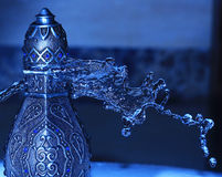 Arabian Oud Bottel Under Shower Royalty Free Stock Photo