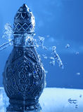 Arabian Oud Bottel Under Shower Stock Photo