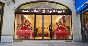 Arabian oud luxury fragrance store in Paris, France. PARIS, FRANCE - CIRCA 2016: Arabian Oud - Luxury Perfume store on the Champs-Elyseess with pedestrian stock video footage