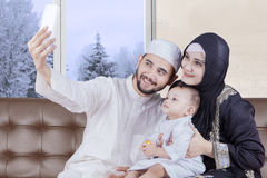 Arabian parents and boy taking selfie picture Stock Photo