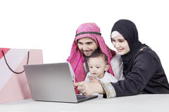 Arabian parents and child looking laptop Royalty Free Stock Photos