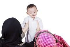 Arabian parents lifting their child Royalty Free Stock Photos