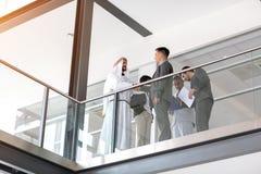 Arabian partner and company manager handshake. In company hall stock image