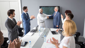 Arabian partner and director of company handshake Royalty Free Stock Image