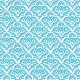 Arabian patterns. Graceful arabesques on a heavenly-blue background Stock Images