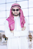 Arabian person standing in the airport Royalty Free Stock Photo