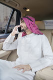 Arabian person talking on the phone in car Royalty Free Stock Photo