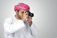 Arabian photographer taking pictures  Royalty Free Stock Photography