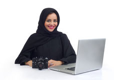 Arabian photographer working on her Laptop at the office Stock Images