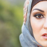 Arabian Portrait. Portrait of a woman, wearing arabian shawl Royalty Free Stock Photo