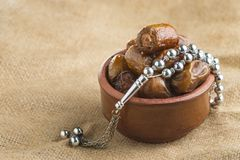 Arabian Ramadan Dried Dates and Rosary. On Vintage Background royalty free stock photography