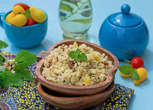 Arabian salad with couscous tabbouleh. Arabian salad with couscous and vegetables tabbouleh on blue background stock photography
