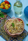 Arabian salad with couscous tabbouleh. Arabian salad with couscous and vegetables tabbouleh on blue background royalty free stock photography
