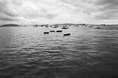 Arabian sea and some schiffs floating in the water on the coastline of Mumbai, India. Arabian sea and some skiffs rowboats floating in the water on the Stock Photo