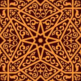 Arabian seamless pattern with a central star. Apabian seamless pattern with a central star and floral elements in a square format suitable as a tile in shades of Stock Image