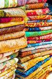Arabian Shawls. A Stack of Brightly Coloured Eastern Shawls Royalty Free Stock Image