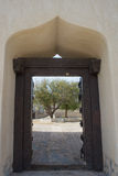 Arabian style archway with wooden door gate Royalty Free Stock Photography