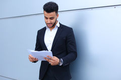 Arabian Successful businessman holds documents, smiling little s Royalty Free Stock Photos