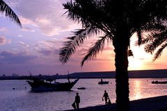 Arabian sunset. An arabian sunset with dhows and palms stock photo