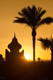 Arabian Sunset. Arabian orange sunset with building and palms Stock Photo