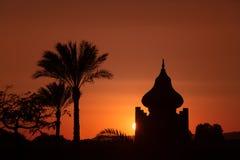 Arabian Sunset. Arabian orange sunset with building and palms Stock Image
