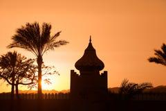 Arabian Sunset. Arabian orange sunset with building and palms Stock Photography