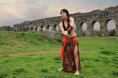 Arabian sword. Arabian Woman with tradition costume holding a sword Royalty Free Stock Image