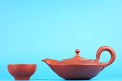 Arabian teapot with teacups. Arabian old ceramic brown teapot with teacups  on blue Stock Image