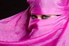 Arabian Woman. Wearing pink headscarf Stock Photo
